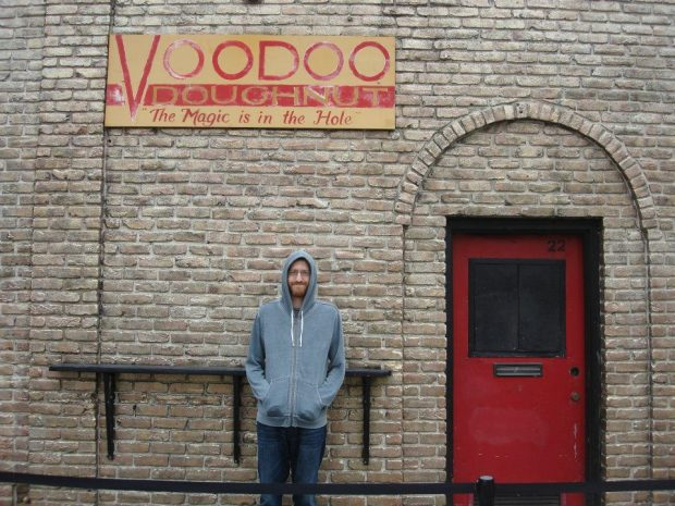 Eric standing outside Voodoo Doughnuts